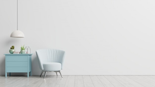 The interior has a armchair on empty white wall Free Photo