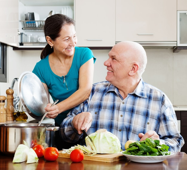 Senior Couple Cooking Vegetarian Lunch Free Photo