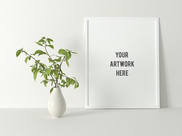 Biała minimalna rama plakatowa makieta z rośliną Premium Psd