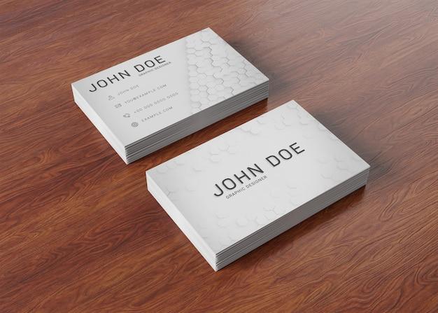 Białe stosy wizytówek na powierzchni drewnianych makieta Premium Psd