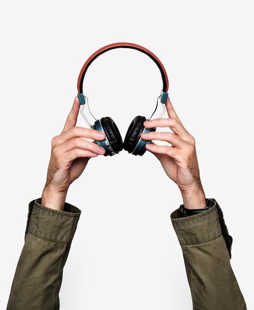 Dłoń Trzymająca Słuchawki Premium Psd