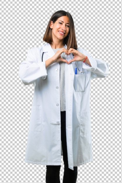 Doktorska kobieta z stetoskopem robi sercu z jego rękami Premium Psd