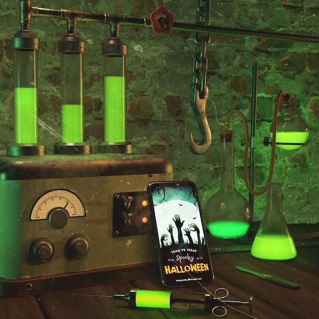 Halloweenowy układ z smartphone i starym haczykiem Darmowe Psd