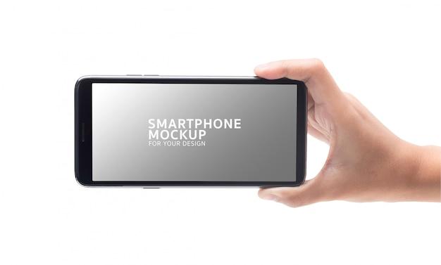 Kobiety ręka trzyma czarnego smartphone mockup dla twój projekta. Premium Psd