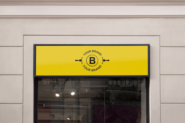 Makieta logo na elewacji lub w sklepie Darmowe Psd