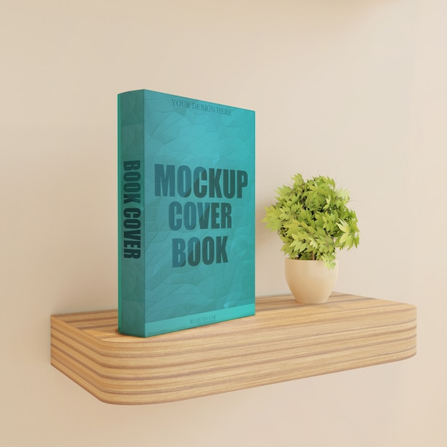 Makieta okładki książki na drewnianej ścianie biurko z rośliną Premium Psd
