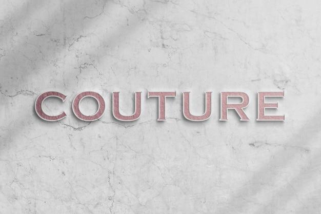 Makieta stylowego logo mody na marmurowej ścianie z realistycznym cieniem Premium Psd