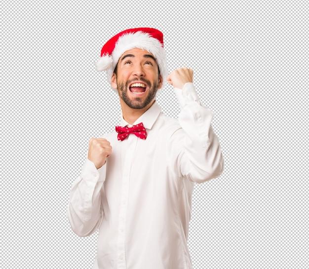 Młody Człowiek Jest Ubranym Santa Claus Kapelusz Na Dniu Bożego Narodzenia Premium Psd