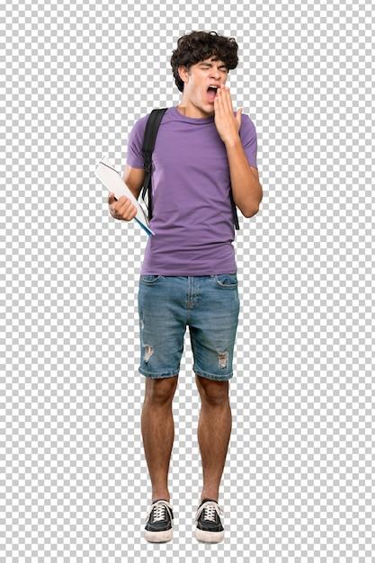 Młody student człowiek ziewanie i obejmujące szeroko otwarte usta ręką Premium Psd