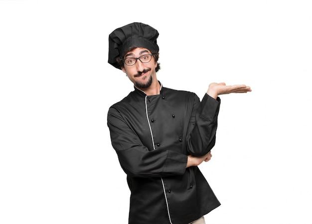 Młody Szef Kuchni O Dziwacznym I Zdezorientowanym Wyglądzie, Wątpiący W Różne Wybory Premium Psd