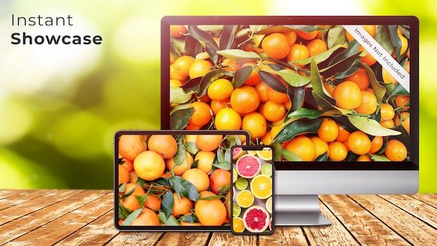 Pixel perfect apple device makieta iphone x, tablet i ekran imaca na rustykalnym drewnianym stole z zielonym, naturalnym, organicznym wzorem bokeh makieta psd Premium Psd