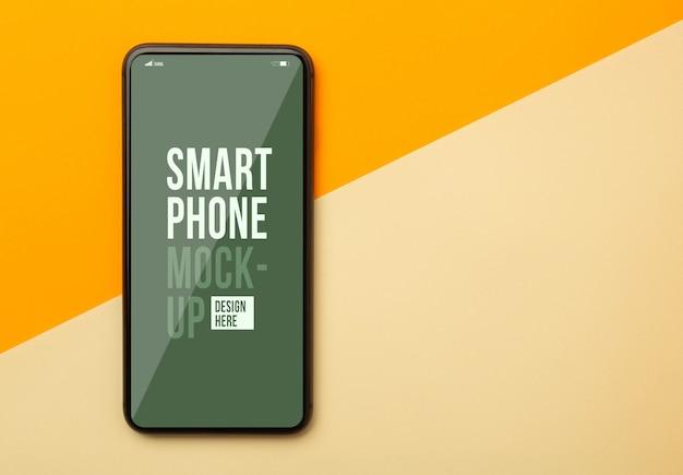 Płaski Układ, Widok Z Góry Pomarańczowego Biurka Biurka Z Szablonem Makieta Smartfona Do Projektowania. Premium Psd