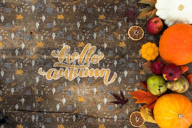 Płaskie ukształtowanie jesiennych zbiorów na drewnianym stole Darmowe Psd