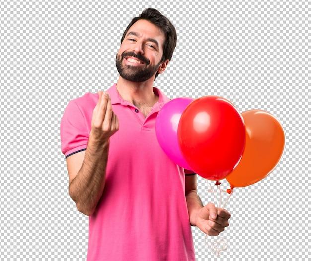 Przystojni Młodego Człowieka Mienia Balony I Robić Pieniądze Gestykulują Premium Psd
