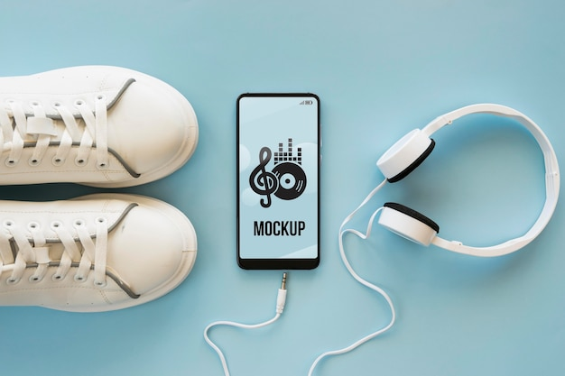 Rozmieszczenie Elementów Muzycznych Na Niebieskim Tle Z Makietą Telefonu Darmowe Psd