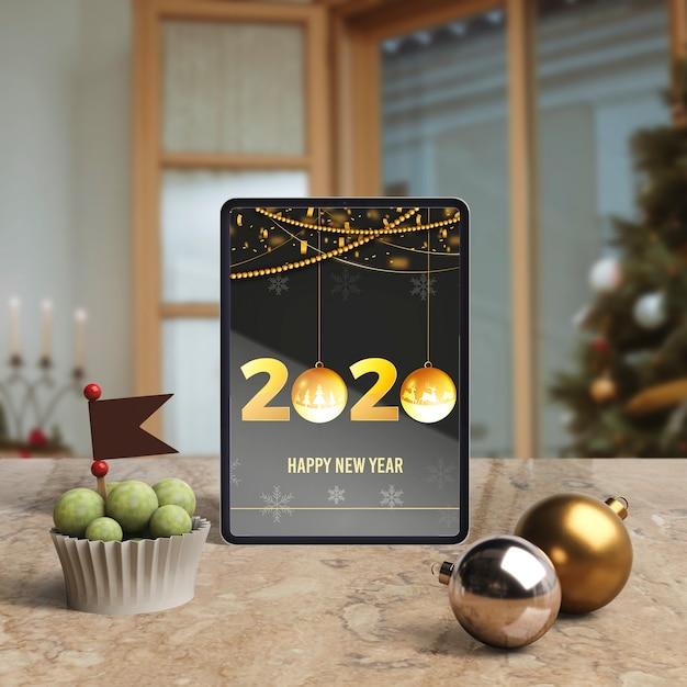 Tablet Z życzeniem Nowego Roku Na Stole Darmowe Psd