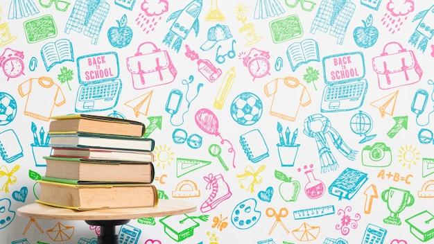 Widok z przodu stos książek z kolorowym tłem Darmowe Psd