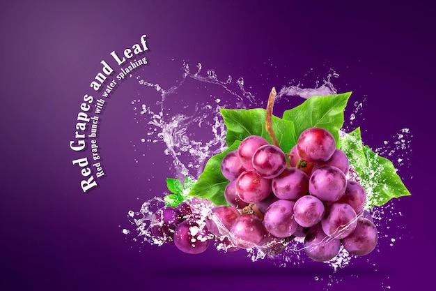 Wody Rozpryskiwania Na świeże Czerwone Winogrona Na Czerwonym Tle. Premium Psd
