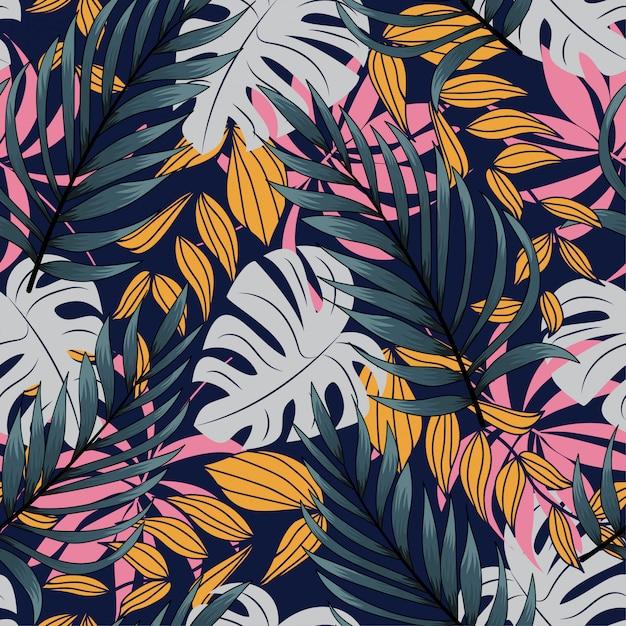 Abstrakcjonistyczny bezszwowy wzór z kolorowymi tropikalnymi liśćmi i roślinami na ciemnym tle Premium Wektorów
