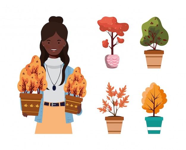 Afro Kobieta Z Jesiennymi Roślinami W Ceramicznych Garnkach Premium Wektorów