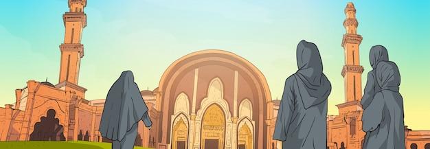 Arabowie przyjeżdżający do meczetu budowanie muzułmańskiej religii ramadan kareem święty miesiąc Premium Wektorów