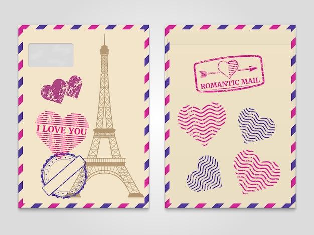Archiwalne romantyczne koperty z wieżą eiffla i znaczkami miłości Premium Wektorów