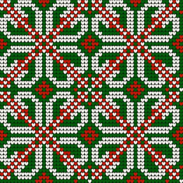 Babci bożenarodzeniowy dziewiarski bezszwowy wzór w czerwonych, zielonych i białych kolorach Premium Wektorów