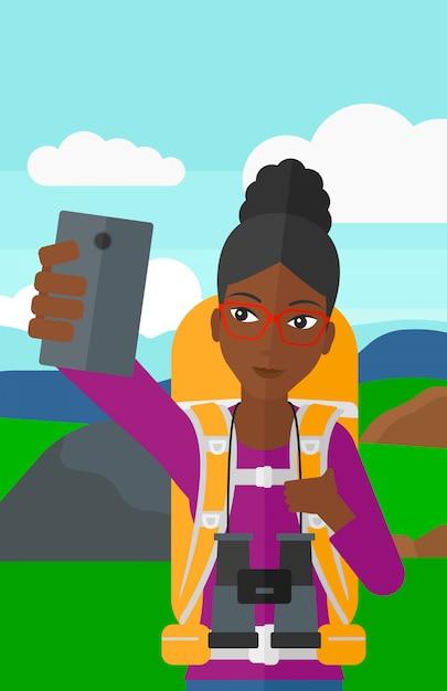 Backpckaer robi selfie. Premium Wektorów