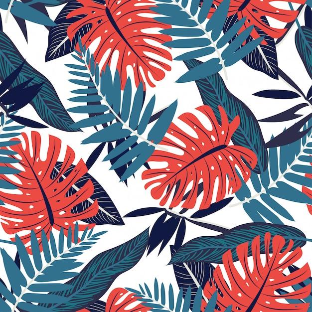 Bezszwowy Wzór Z Kolorowymi Czerwonymi I Błękitnymi Tropikalnymi Roślinami Premium Wektorów