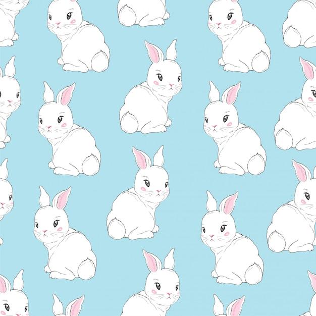 Bezszwowy wzór z kreskówek królikami dla dzieciaków Premium Wektorów
