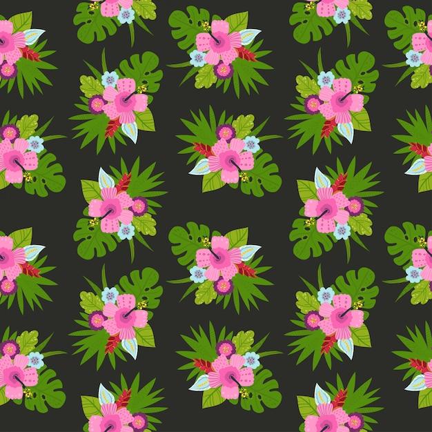 Bezszwowy wzór z tropikalnymi liśćmi i kwiatami. Premium Wektorów