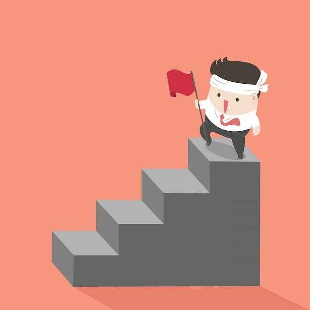 Biznesmen na najwyższych schodach. Premium Wektorów