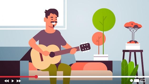 Bloger Muzyczny Nagrywający Strumień Wideo Online Dla Vloga Męski Vloger Gra Na Gitarze Blogowanie Koncepcja Nowoczesny Salon Wnętrze Poziome Premium Wektorów