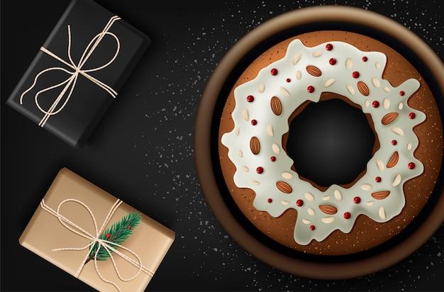Boże narodzenie tort z owocami i dokrętkami na drewnianym stole, odgórny widok. Premium Wektorów