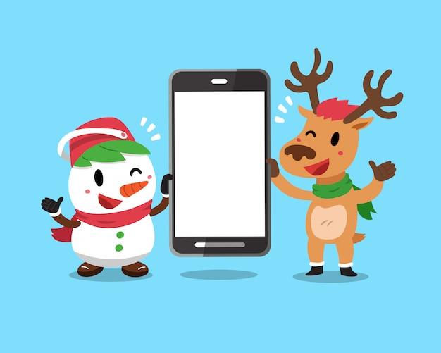 Bożenarodzeniowy Bałwan I Renifer Trzyma Dużego Smartphone Premium Wektorów