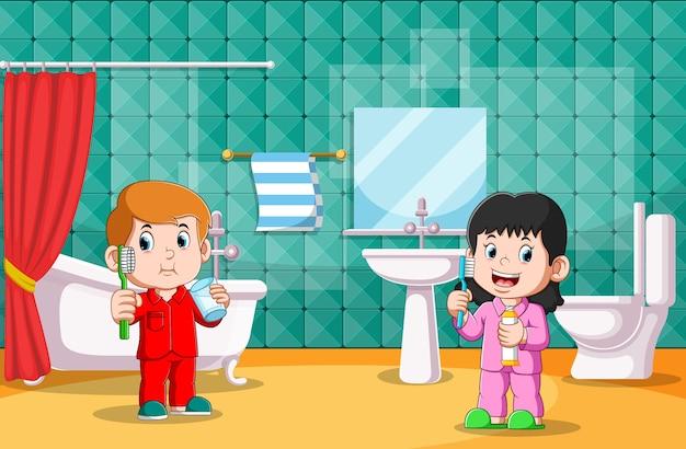 Chłopiec I Dziewczynka Razem Myją Zęby W Toalecie Premium Wektorów
