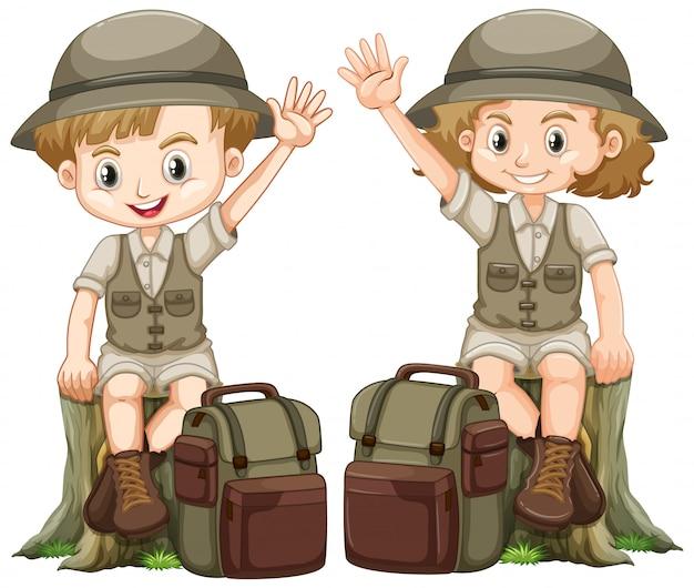Chłopiec I Dziewczynka W Stroju Safari, Siedząc Na Dziennik Darmowych Wektorów