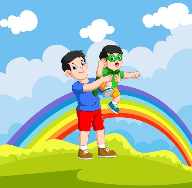 Chłopiec Używa Kostiumu Superbohatera I Bawi Się Z Ojcem Premium Wektorów