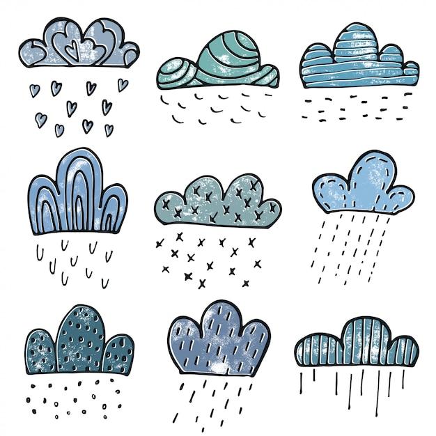 Chmury doodle zestaw w stylu wyciągnąć rękę Premium Wektorów