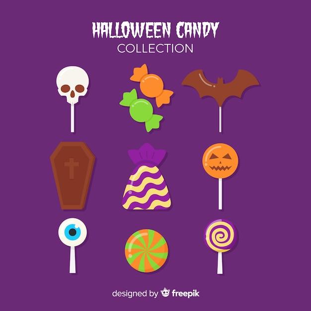 Cukierek albo psikus cukierki na halloween na purpurowym tle Darmowych Wektorów
