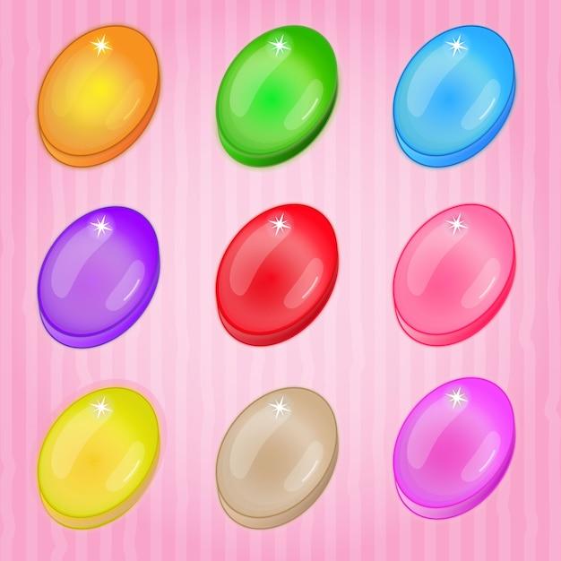 Cukierki owalne kolorowe mecz 3 gry. Premium Wektorów
