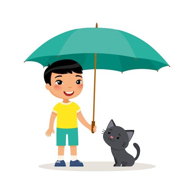 Czarna kiciunia i śliczna mała azjatykcia chłopiec z parasolem. Premium Wektorów