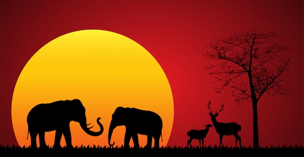 Czarna sylwetka słonia i jelenia Premium Wektorów