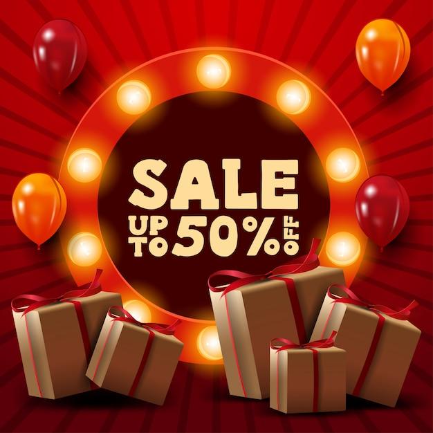 Czerwony sztandar ze zniżką do 50%, prezenty, balony i okrągły znak z ofertą Premium Wektorów