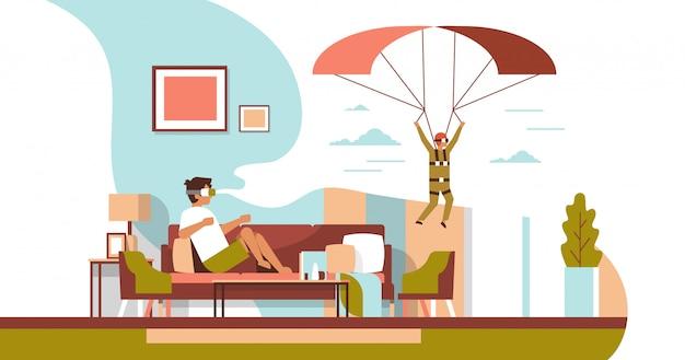 Człowiek nosić okulary cyfrowe rzeczywistość wirtualna latający spadochron facet vr wizja zestaw słuchawkowy innowacje Premium Wektorów