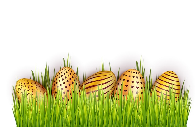 Dekorujący Złoci Wielkanocni Jajka W świeżej Zielonej Trawie Odizolowywającej Na Białym Tle Premium Wektorów