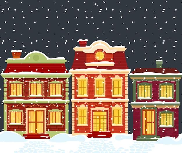 Domy Bożonarodzeniowe. Kreskówka Zimowy Krajobraz Miasta, Kamienice Ze światłami I Dekoracjami świątecznymi Premium Wektorów