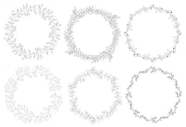 Doodle ręcznie rysowane kolekcji wieniec naturalny jesień Premium Wektorów