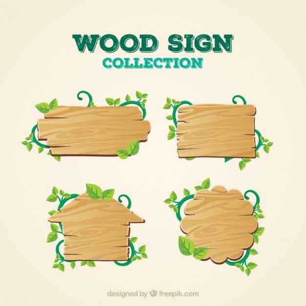 Drewniane Znaki Z Gałęzi I Liści Premium Wektorów
