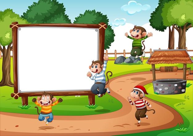 Drewniany Pusty Baner Na Scenie Parku Z Czterema Małpami Premium Wektorów